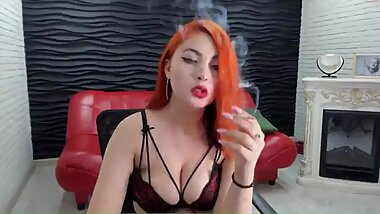Spectacular redhead girl smokes seductively